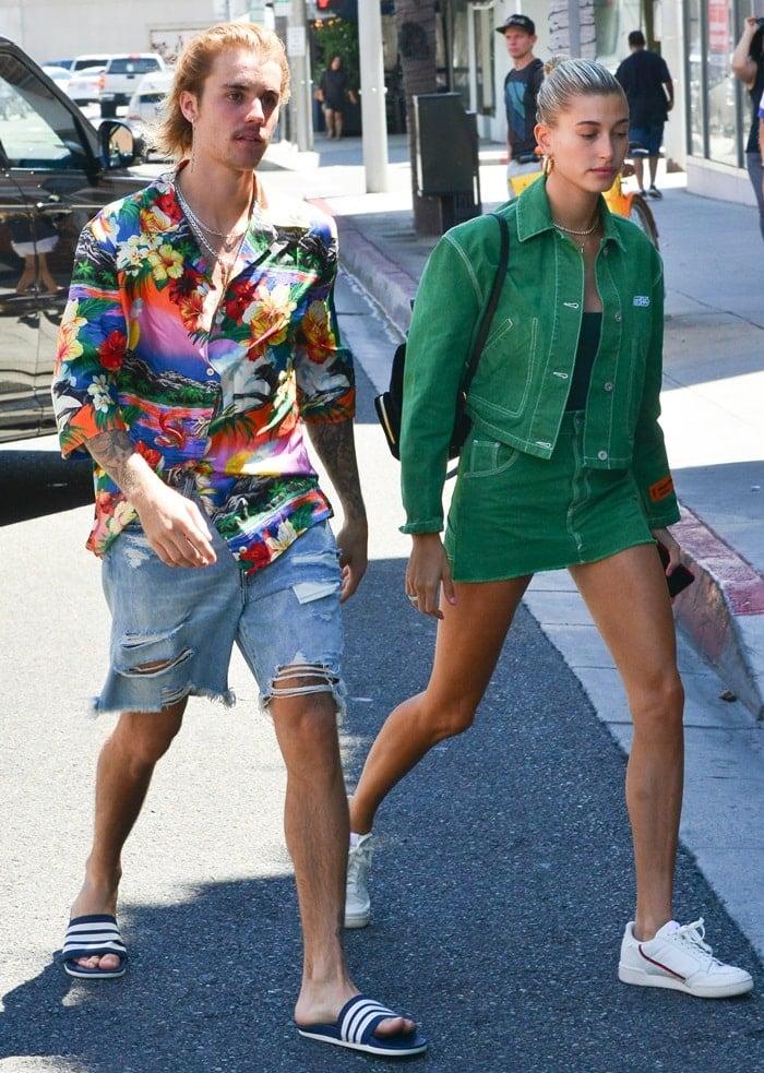 Hailey Baldwin flaunted her hot legs in a greenHeron 'Preston' cotton crop denim jacket paired with a matchingcotton workwear denim skirt
