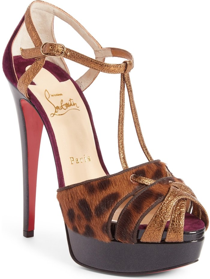 Leopard-printed calf hair mixes with gilded leather and plum-hued suede, tripling the glamorous style of a strappy platform pump set on a soaring stiletto heel and finished with that iconic red sole.