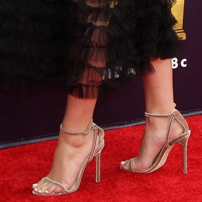Lily Reinhart shows off her sexy feet in velvet Jimmy Choo sandals