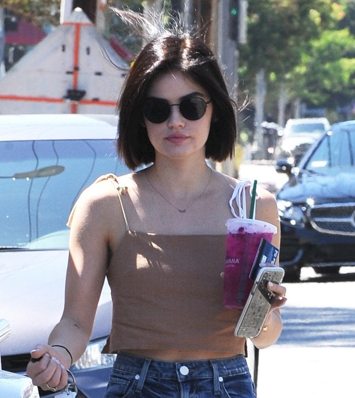 Lucy Hale shows off her short hair in a Donni cover-up crop top