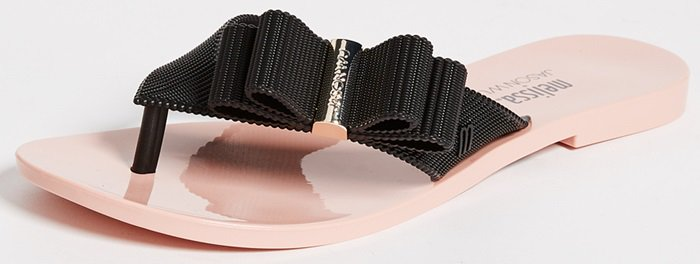 A curvy layered bow sits pertly on the textured strap of a wear-everywhere flip-flop designed in collaboration with Canadian artist and designer Jason Wu.