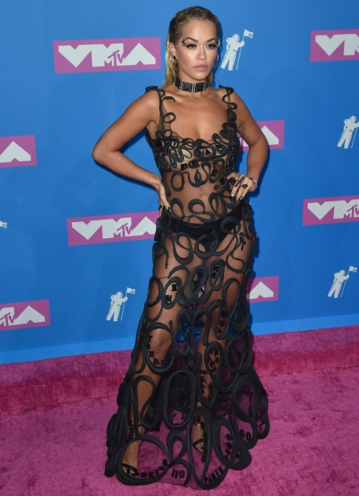 Rita Ora rocks black satin 'Rose' sandals from Giuseppe Zanotti's Resort '19 Collection with rose embellishment