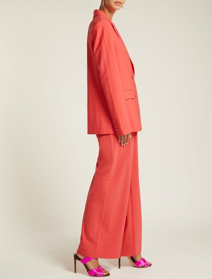 Model wearing Tibi's pink wide-leg Stella pants with a matching classic Steward double-breasted blazer