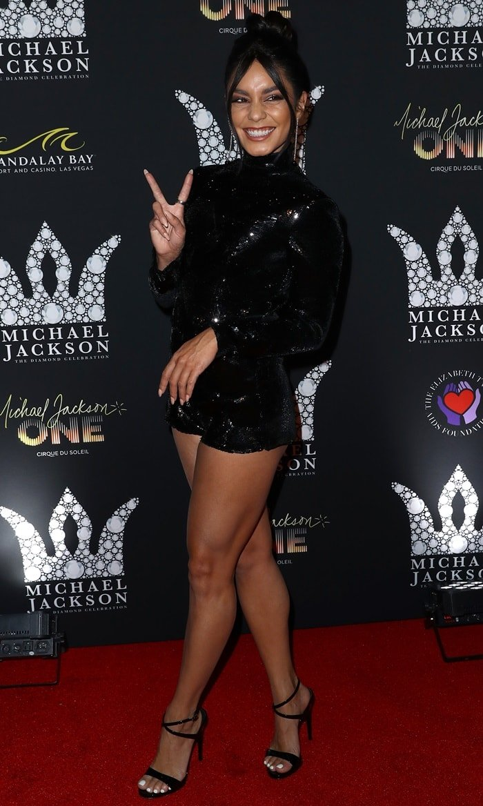 Vanessa Hudgens shows off her toned legs in a sparkly black romper from Galia Lahav