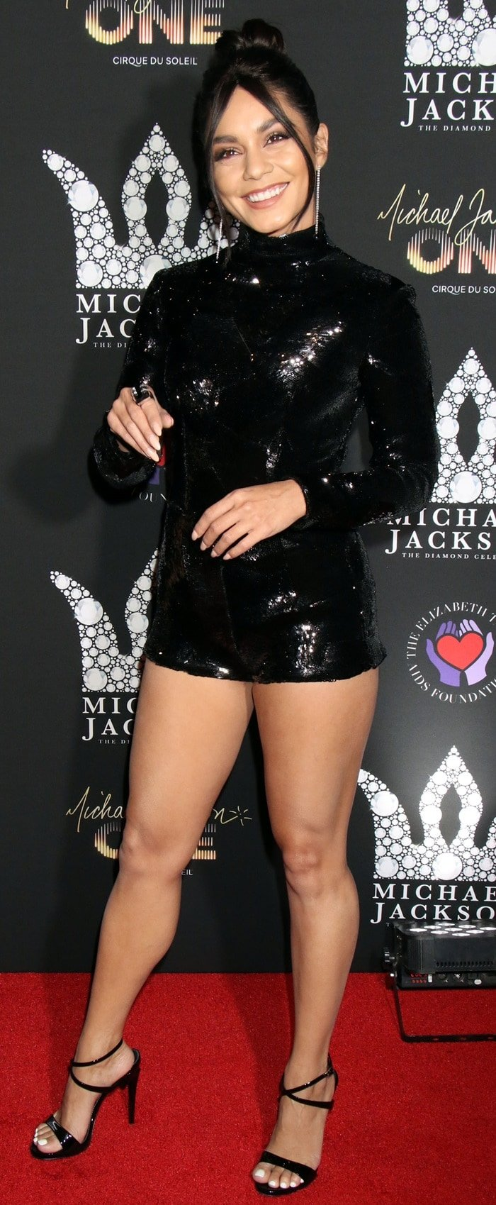 Vanessa Hudgens adds several inches of height with Giuseppe Zanotti's black patent 'G Heel' sculpted sandals