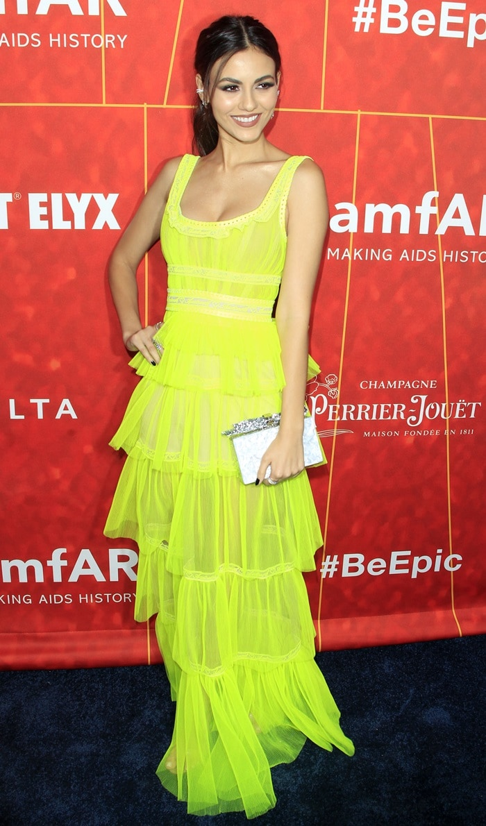 Victoria Justice styled her Clearer sandals withayellow tiered dress from Aadnevik's Spring 2019 Collection