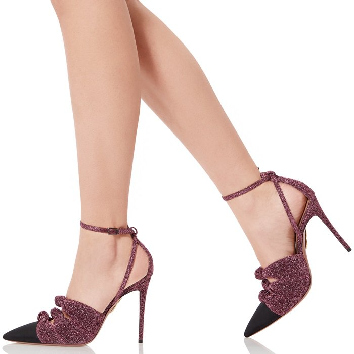 The pair features an elegant pointed toe, a sky-high stilleto heel and slim straps that flatter the ankle