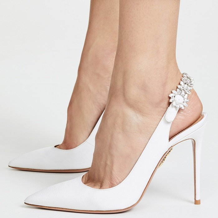Equally timeless and elegant, this pair is crafted from lustrous white grosgrain and has an adjustable slingback strap that's decorated with light-catching crystals.
