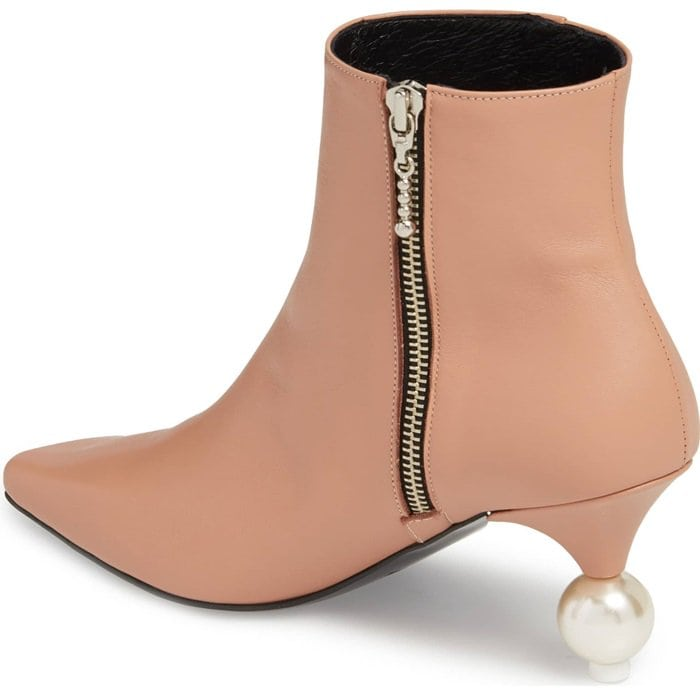 A pearly orb and a curvy cone form the statement heel of a streamlined, minimalist bootie styled with a sharply blunted toe