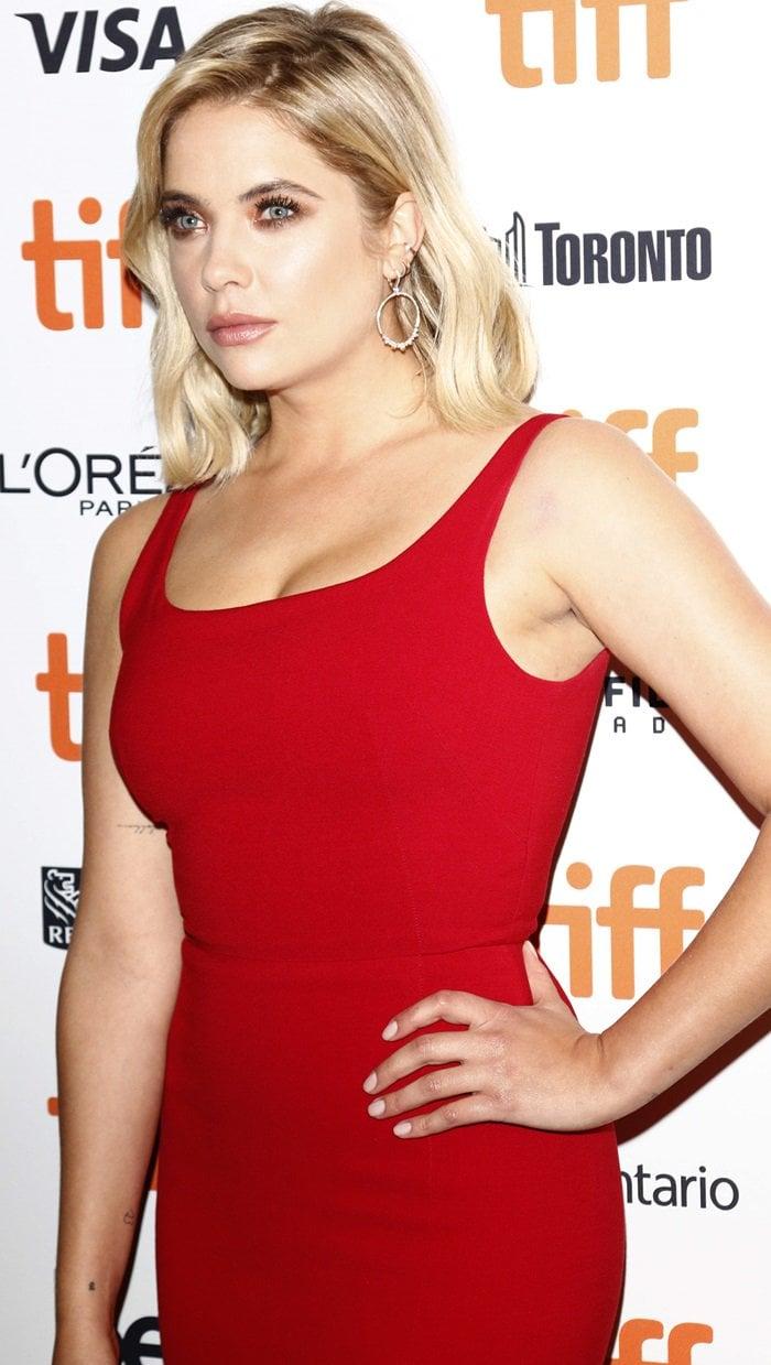 Cara Delevingne's girlfriend, Ashley Benson, in a figure-hugging red dress