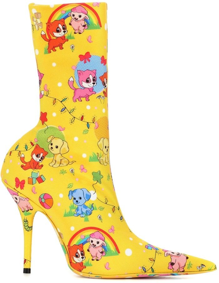 Featuring a sock-like fit, Balenciaga's yellow, blue, and multicolored tech-jersey Knife ankle boots showcase a whimsical puppy cartoon motif
