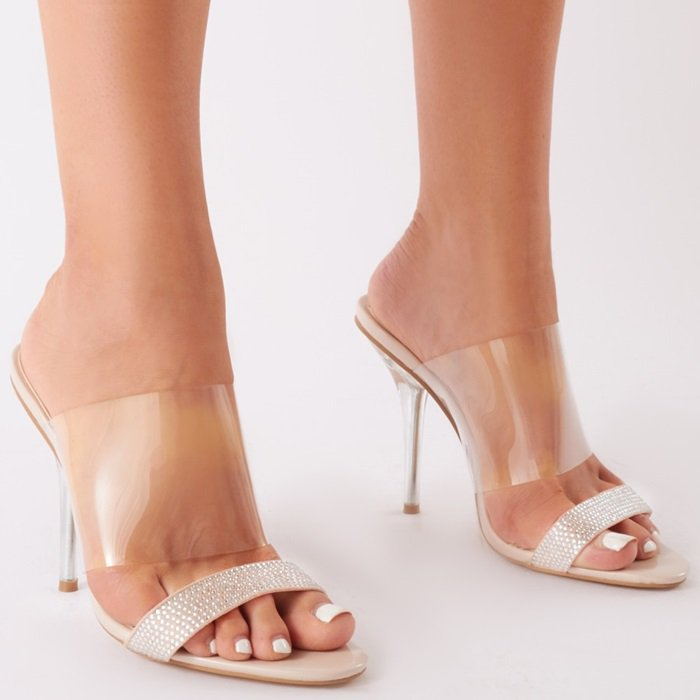 These clear perspex sandals feature a diamond toe strap