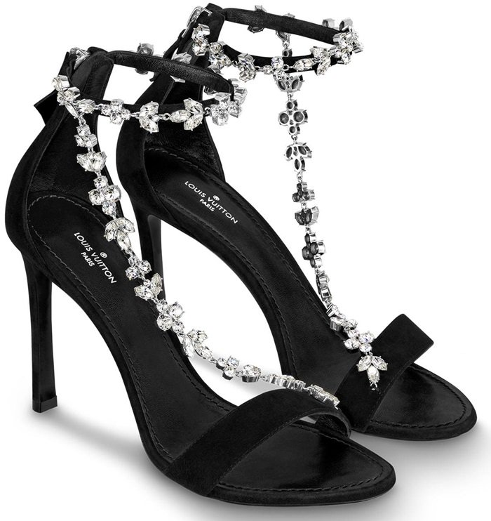 Combining velvet-black suede baby goat leather with brilliant strass, the Black Bird high-heeled sandal is a jewel-like design which adorns the feet with sparkling chains of Monogram Flowers