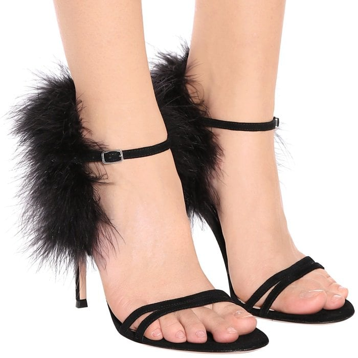 Sumptuous feather trim running around the ankles and back strap of Gianvito Rossi's vertiginous Thais sandals lends the pair playful flair