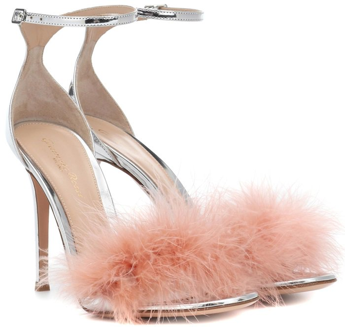 "Crafted in Italy from silver-tone metallic calf leather, the style features ""Dahlia"" pink feather trim across the banded front and a slim ankle strap with buckle closure"
