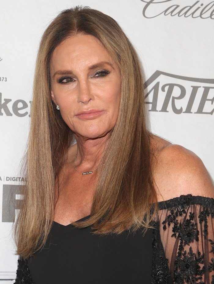 Caitlyn Jenner wearing her 'Caitlyn' necklace and a sexy black dress