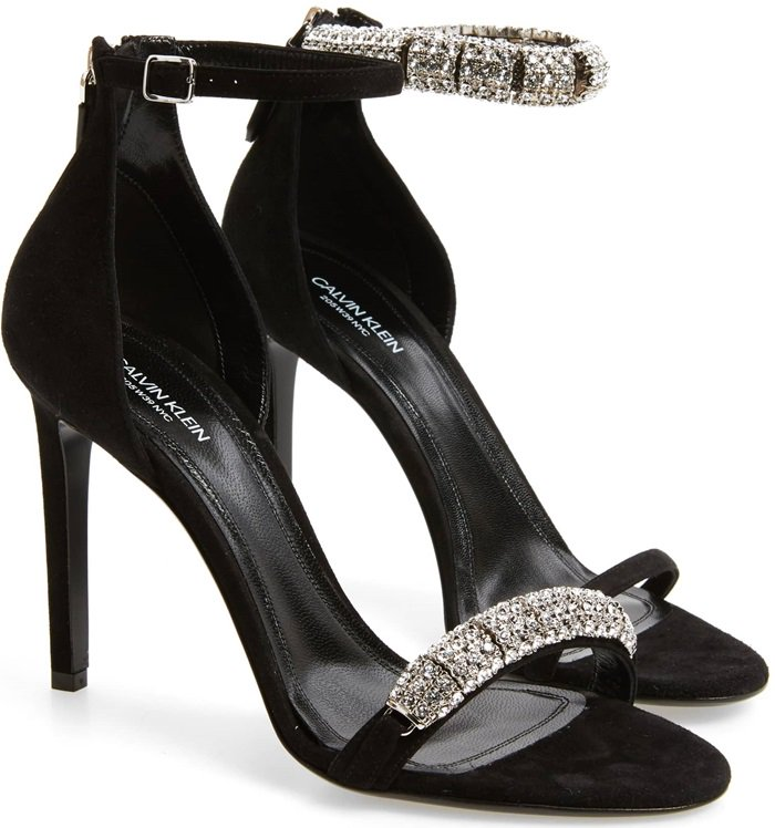 Rows of crystals dazzle and shine on a lofty, calfskin-suede sandal finished with a slim ankle strap.