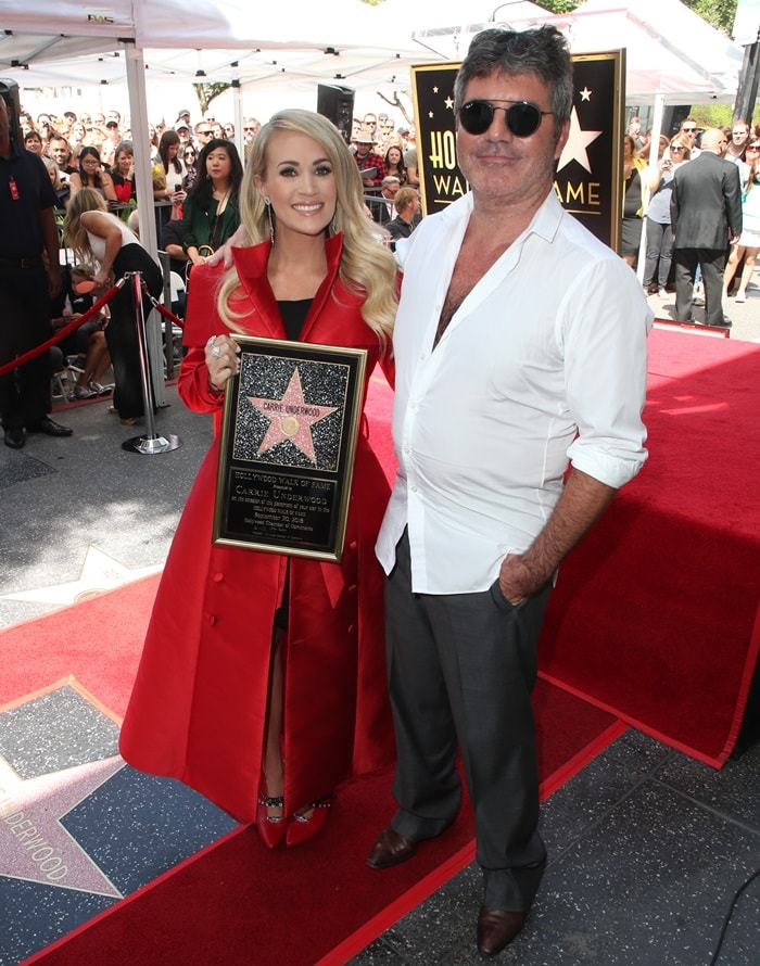 Carrie Underwood, posing with Simon Cowell,receives a star on the Hollywood Walk of Fame in Hollywood on September 20, 2018