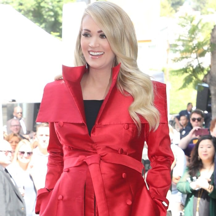 Carrie Underwood ina red coat dress from John Paul Ataker's Fall 2018 Collection