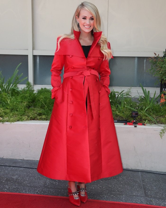 Carrie Underwood styled her coat with Maxine mules from Finnish shoe designer Minna Parikka