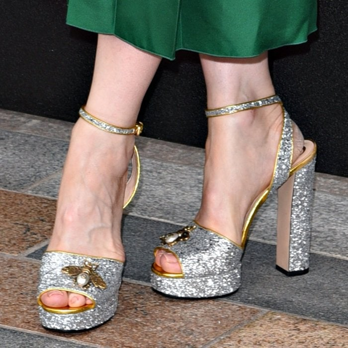 Cate Blanchett shows off her sexy toes in glittered ankle-strap sandals with metallic bee applique from Gucci