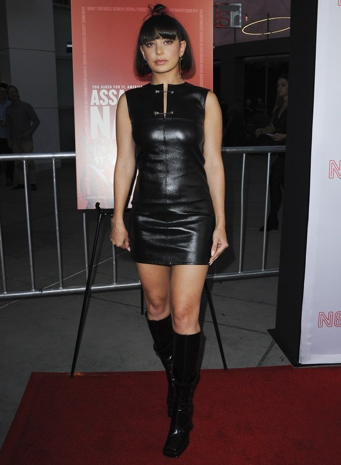 Charli XCX in a safety pin silk-lined leather shift dress by Helmut Lang