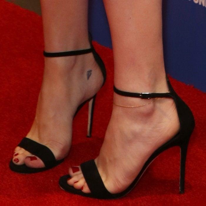 Chloë Grace Moretz shows off her feet in black ankle-strap sandals