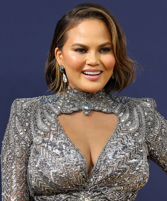 Chrissy Teigen flaunts her curvesin an embellished gown from the Zuhair Murad Fall 2018 Couture Collection