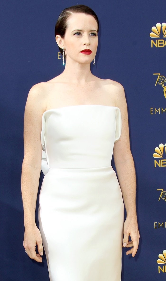 Claire Foy looked glamorous in an optic white double-faced silk satin dress and Kwiat jewelry