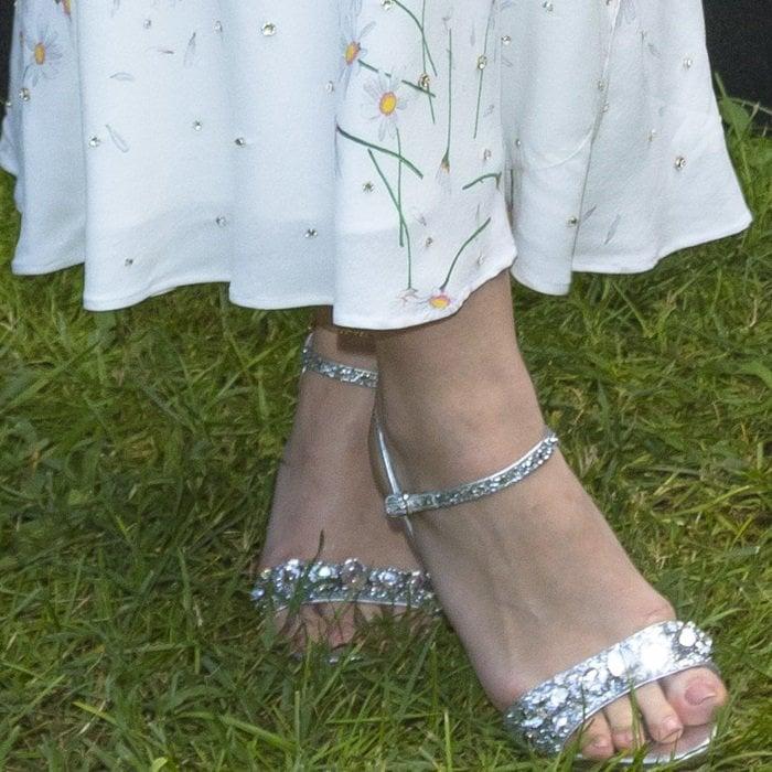 Dakota Fanning shows off her bare feet insilver embellished sandals