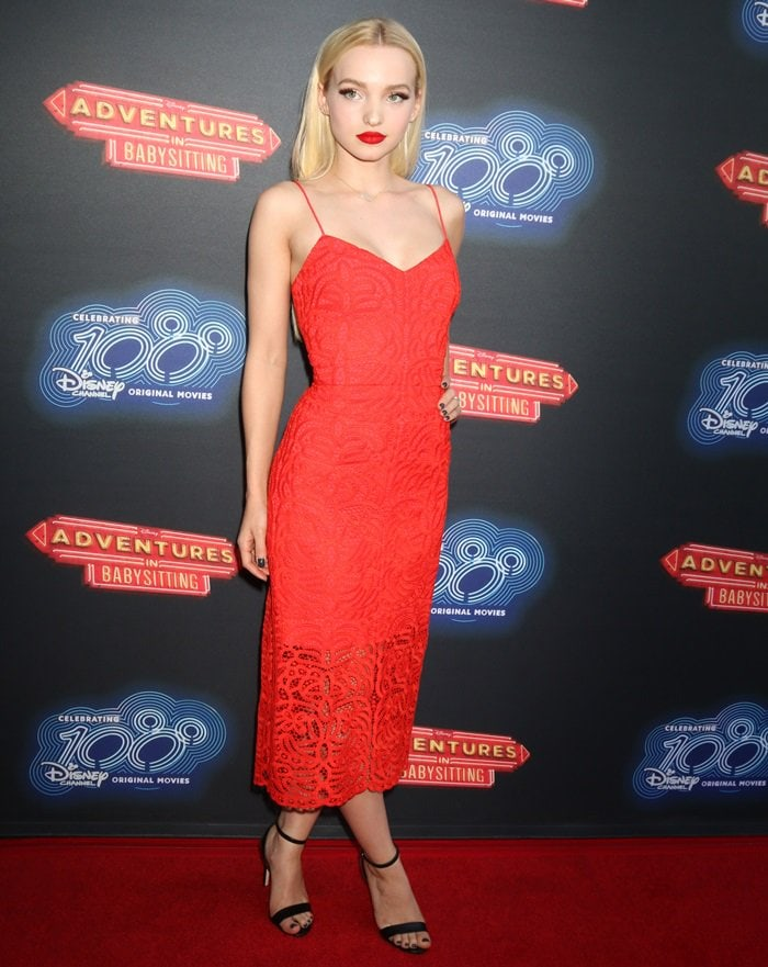 Dove Cameron in a red spaghetti-strap lace dress by Cynthia Rowley while attending the premiere of 'Adventures in Babysitting' at the DGA Theatre in Los Angeles on June 23, 2016