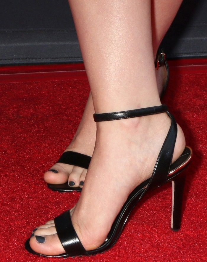 Dove Cameron flaunting her perfectly pedicured toes