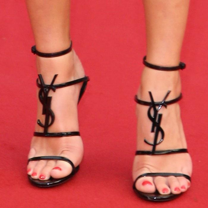 Dua Lipa shows off her feet in Saint Laurent's Cassandra strappy sandals