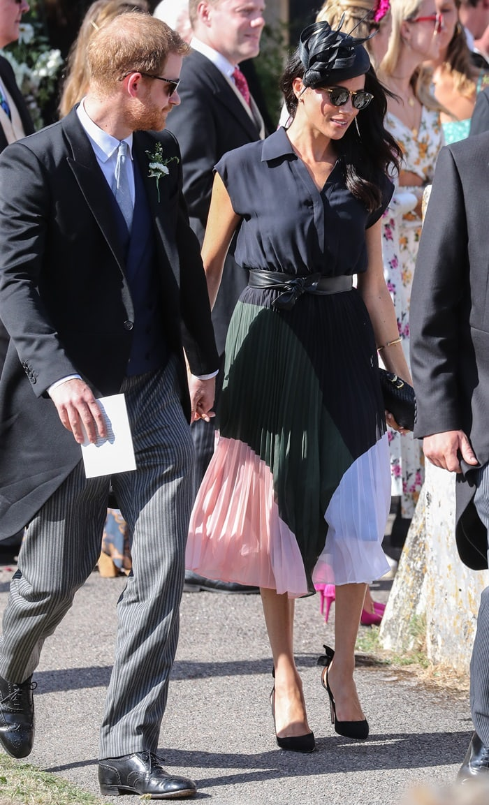 Duchess Meghan Markle arriving for the wedding of friends Charlie van Sraubenzee and Daisy Jenks at St. Mary the Virgin Church in Surrey, England, on August 4, 2018
