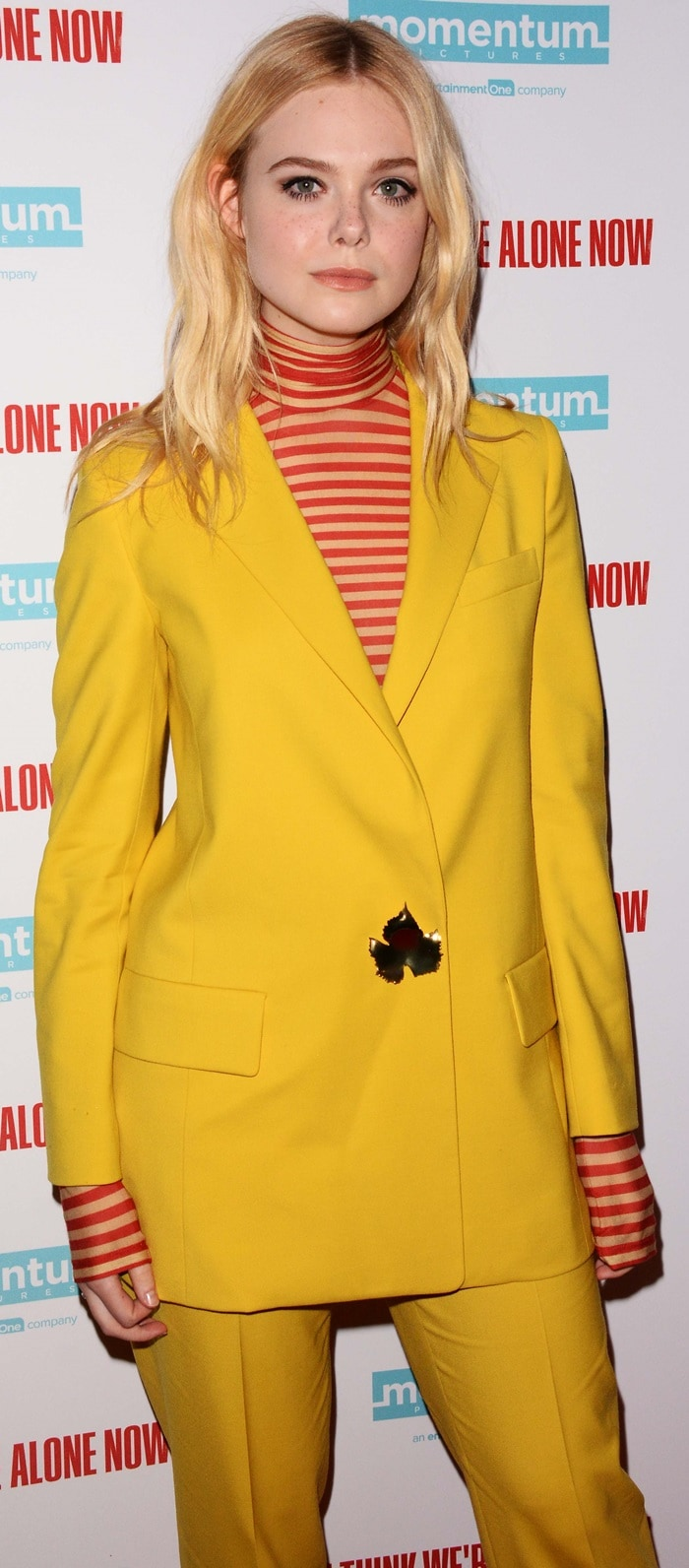 Elle Fanning wearing a yellow suit from the Oscar de la Renta Resort 2019 Collection