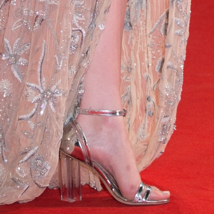 Emma Stone shows off her feet in Louis Vuitton sandals