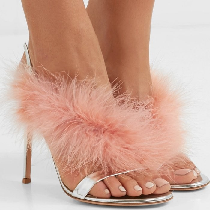 Set on a leg-lengthening 105mm/ 4 inches stiletto heel, they're made from mirrored-leather and trimmed with fluffy feathers that brush the top of the foot