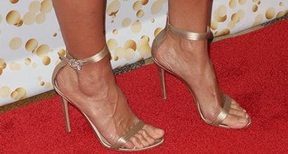 6d2e913f8 Heidi Klum s Sexy Feet Sparkle in Crystal-Embellished Buckle Sandals