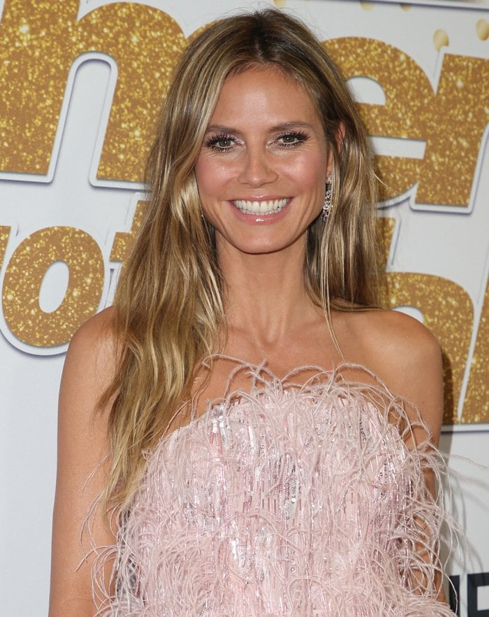 Heidi Klum in a feathered pale pink Pamella Roland Resort 2019 cocktail dress