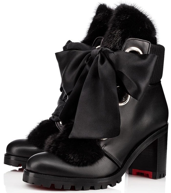 Bold design details—oversized grommets, a rib-knit counter and a stacked, lug heel—balance the silky bow and plush mink fur trim on a calfskin bootie with plenty of streetwise chic