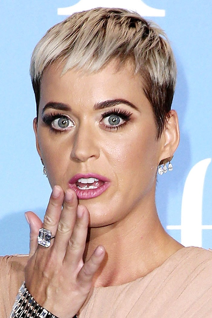 Katy Perry wearing a giant square-cut diamond ring while mid-way to blowing a kiss to the cameras