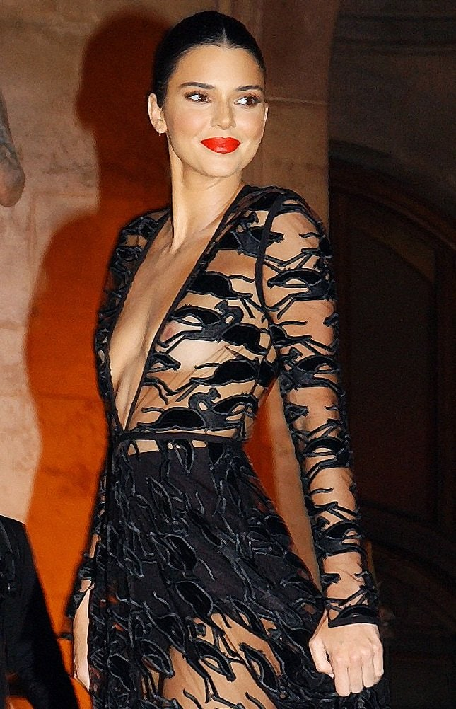 Kendall Jenner exposing her nipples and high-waisted black underwear in a sheer gown