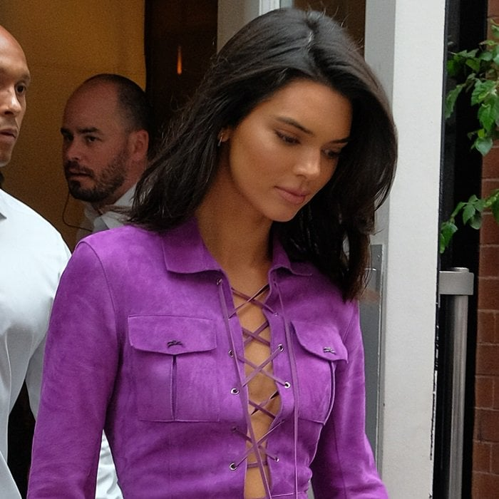 Kendall Jenner leaving her hotel in New York wearing a lace-up, purple suede dress on September 8, 2018
