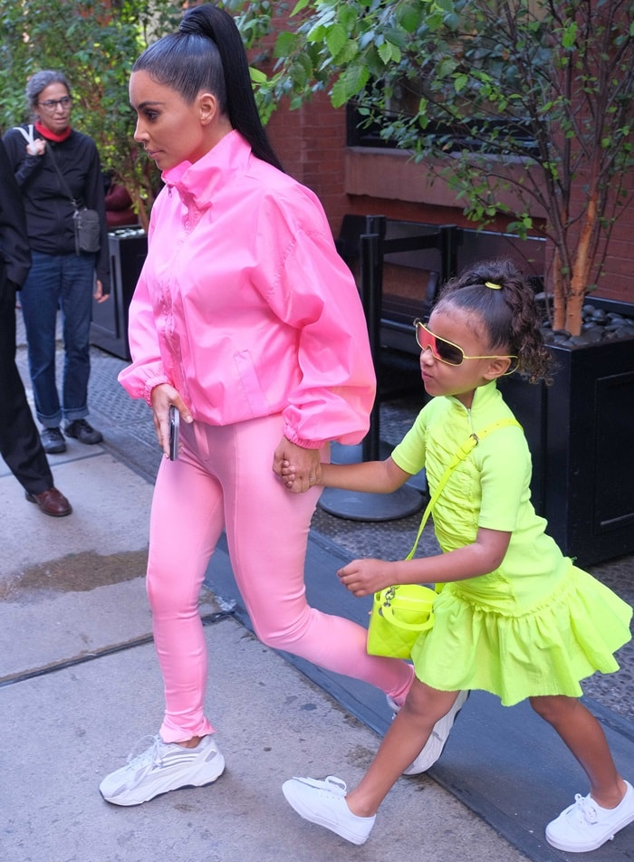 Kim Kardashian styled her pink Balenciaga stretch-satin skinny pants with Yeezy sneakers