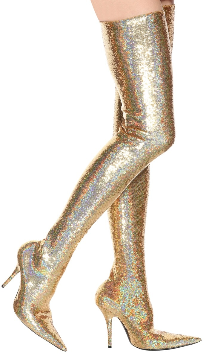 The must-have silhouette of the season, shiny gold sequins cover Balenciaga's statement-making Knife thigh-high boots