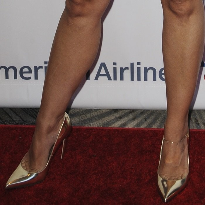 Kristen Bell's hot feet in gold 'Valerie' pumps by Brian Atwood