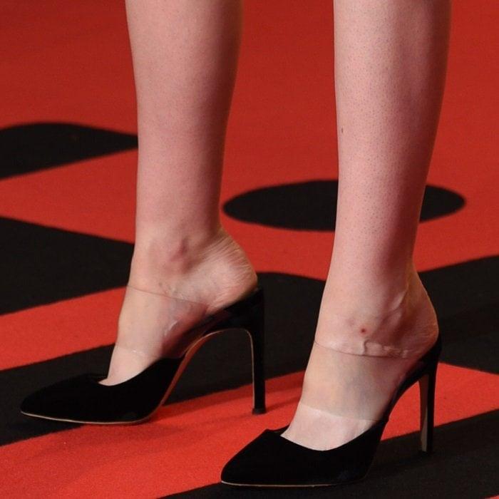 Kristen Stewart shows off her feet and legs in Tara velvet & PVC mules