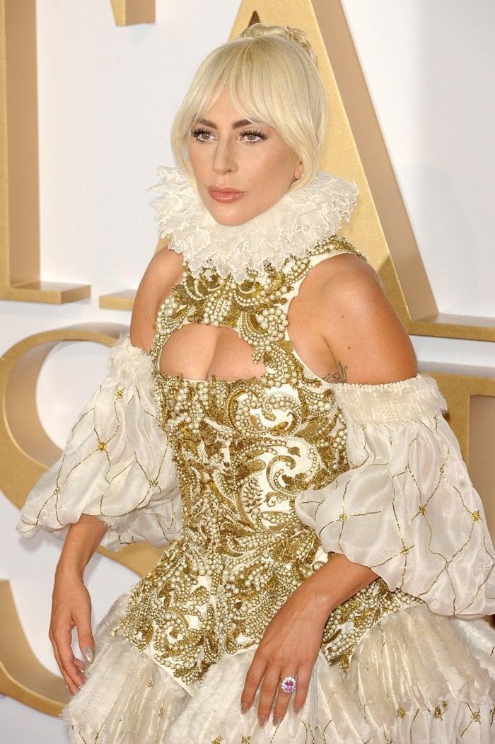 Lady Gaga's dress featuresan Elizabethan-inspiredgold embellished corset-style bodice