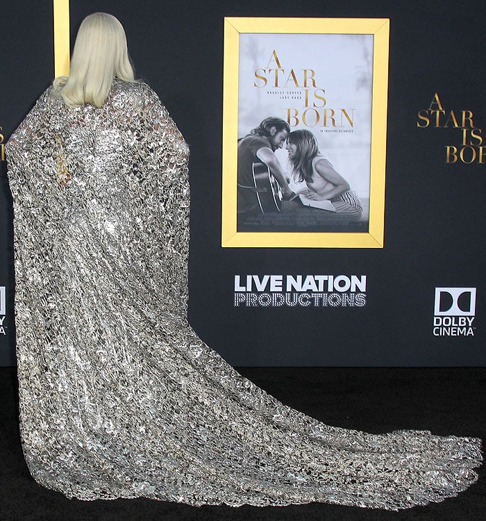 Lady Gaga showing off the cape at the back of her silver Givenchy Couture gown.