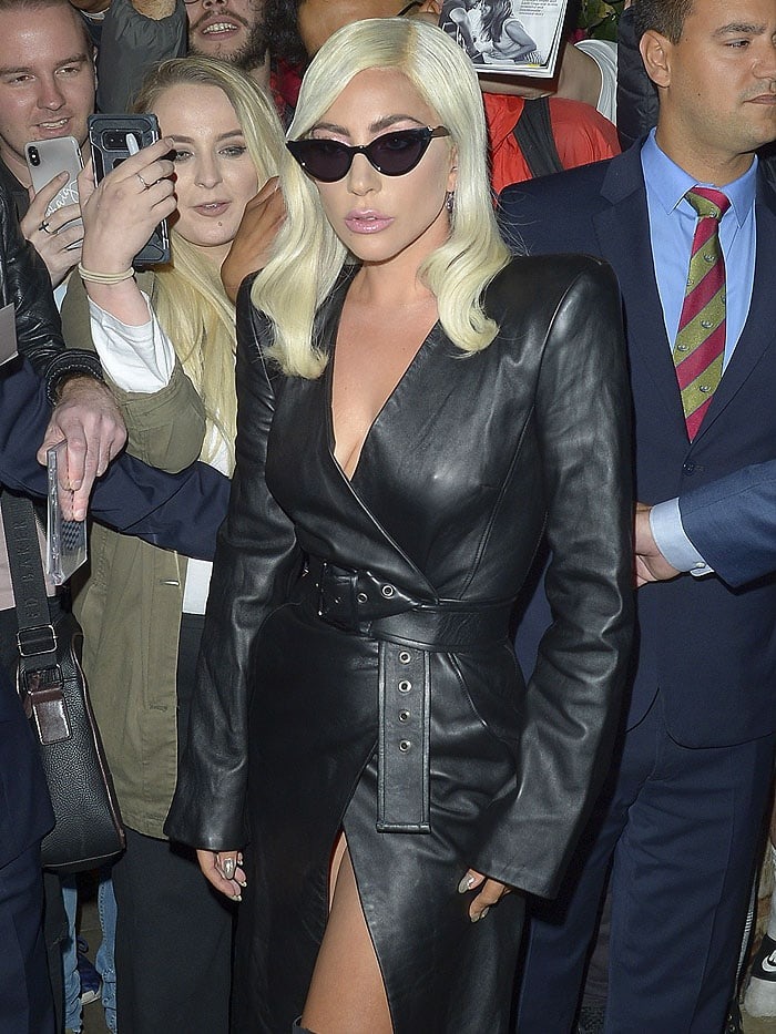 Lady Gaga flashing her lady bits in a Gareth Pugh belted leather trench dress